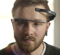 Photo of man wearing Mindwave device with Google Glass